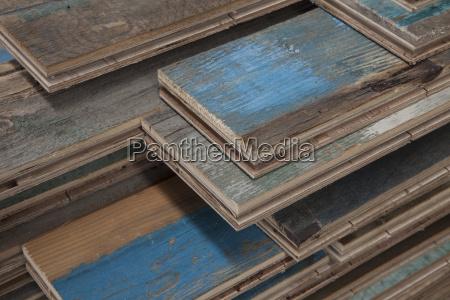 stacks of treated wood flooring in