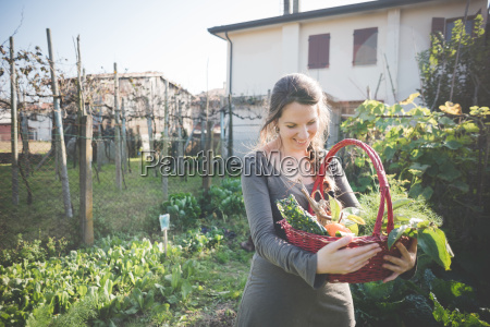 young woman with basket of homegrown
