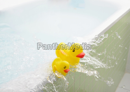 rubber ducks falling out of bath