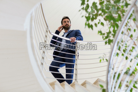 young businessman talking on smartphone on
