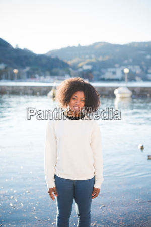 portrait of young woman on lakeside