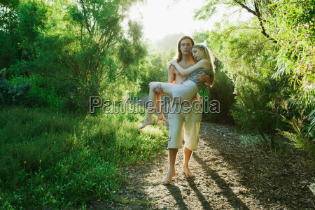 young man carrying young woman