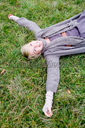 woman lying backside on grass