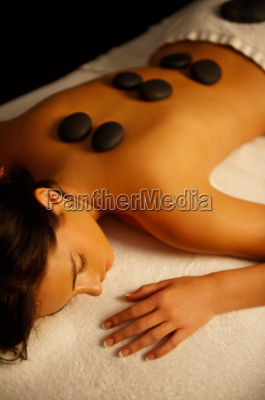 woman receiving hot stone massage