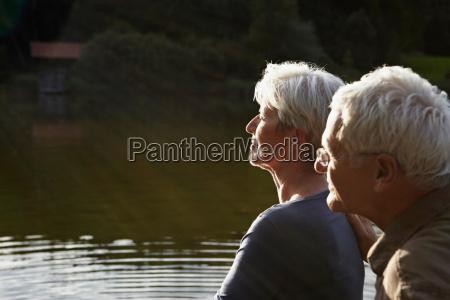 senior couple enjoying sunset