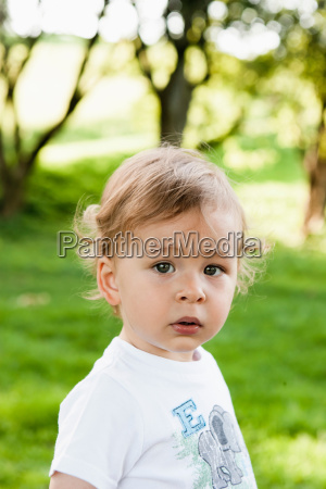 toddler standing in park