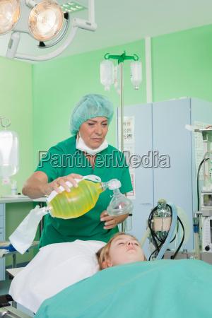 doctor preparing respirator for patient