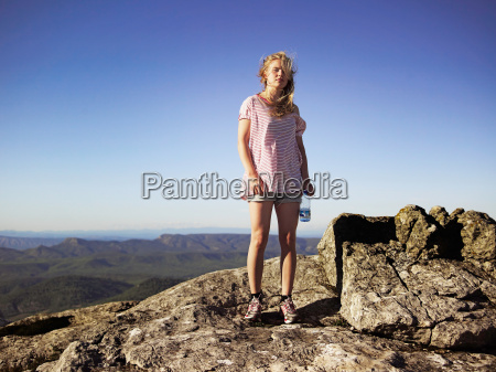 hiker standing on top of rocky