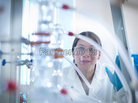 female scientist looking at equipment in