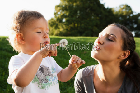 mother and toddler playing in park