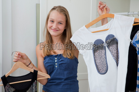 girls picking outfits in bedroom