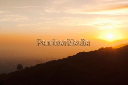 silhouette of hillside at sunset