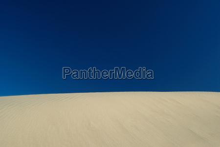 sand dune under blue sky
