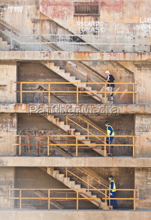 workers climbing steps on dry dock