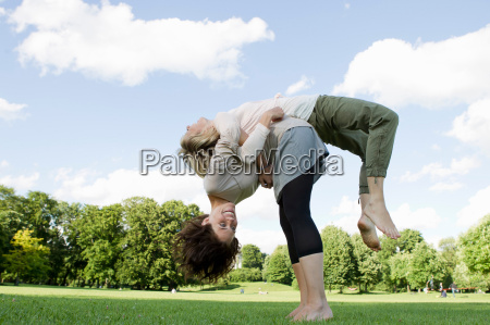 women playing together in park