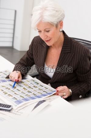 woman working on a paper