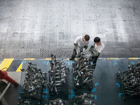 high angle view of engineers inspecting