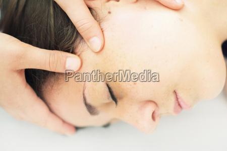 close up of woman having scalp