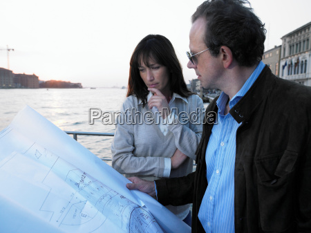 couple looking at architects blueprint