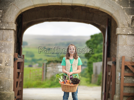 portrait of girl holding basket of