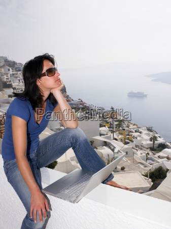 woman with laptop sitting on a