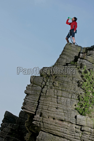 rock climber standing on rock formation