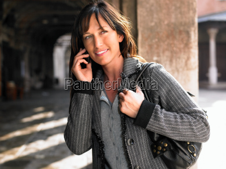 woman talking on mobile phone venice