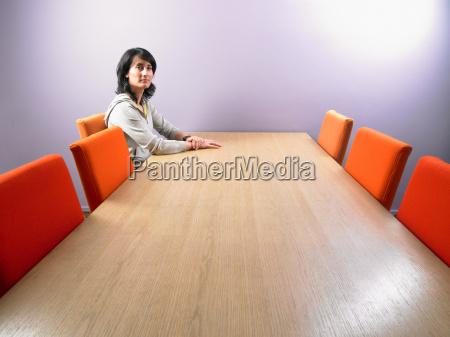 woman waiting at meeting table