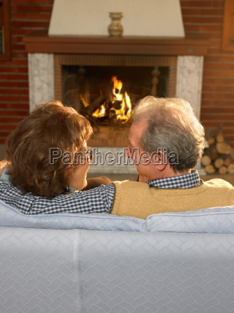 senior couple sitting on a couch
