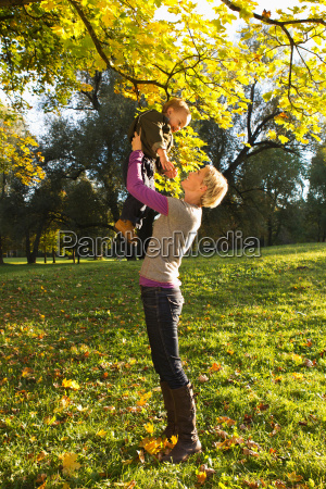 mother and son playing in park