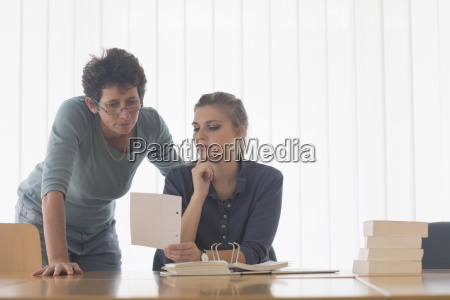 librarian and female student reading file
