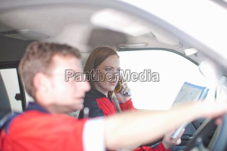 paramedics in ambulance driving to emergency