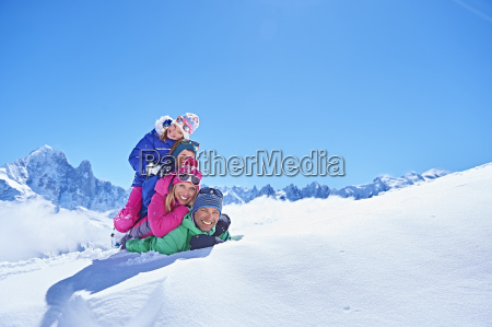 family playing in snow chamonix france