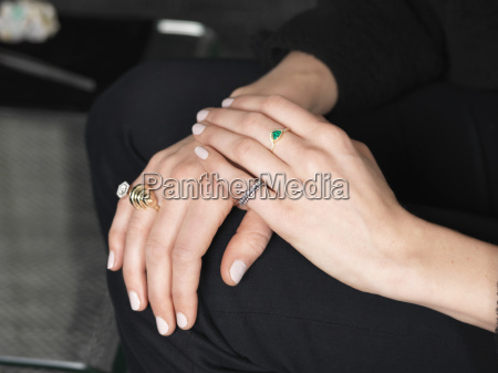 hands of female jeweler wearing variety