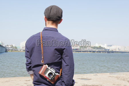 rear view of male tourist looking