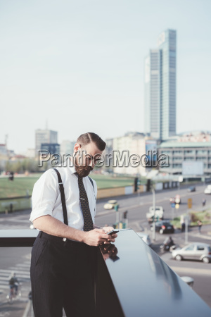 businessman reading smartphone text update on