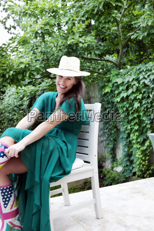 young woman wearing green dress and