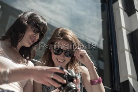 two women wearing sunglasses reviewing