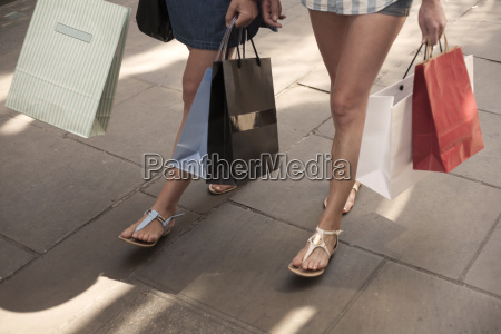 bare legs and feet of two