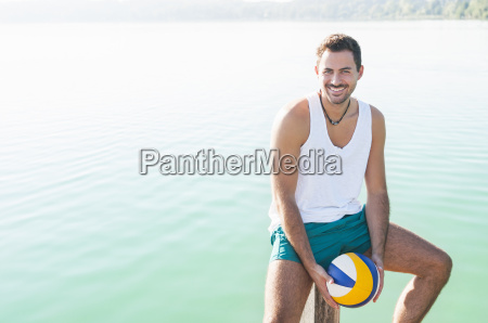 portrait of young man with beachball