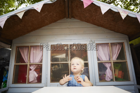 baby girl sitting at table in