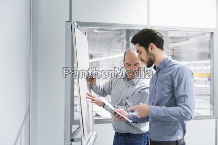two businessmen having brainstorm meeting in