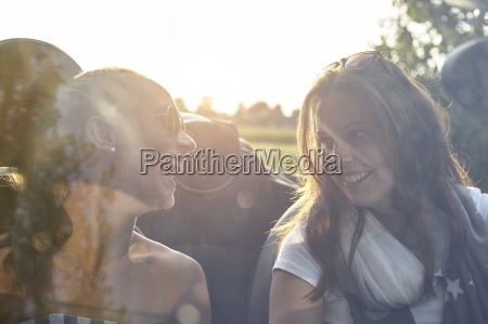 two young female friends chatting in