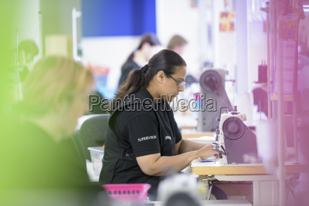 workers sewing orthopaedic garments in factory