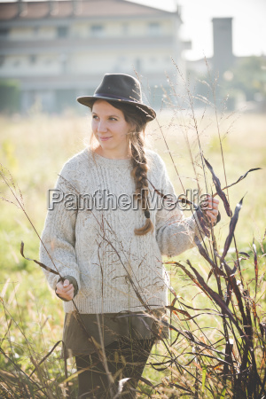 young, woman, wearing, hat, touching, plants - 18405228