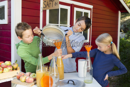 teenage boy and siblings pouring fresh