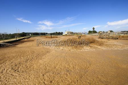 view of brown sludge treatment pool