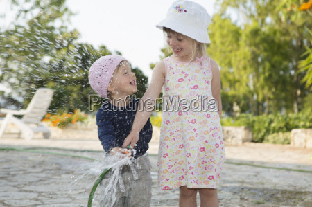 girl and toddler sister playing with