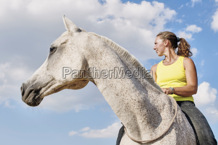 low angle view of woman riding