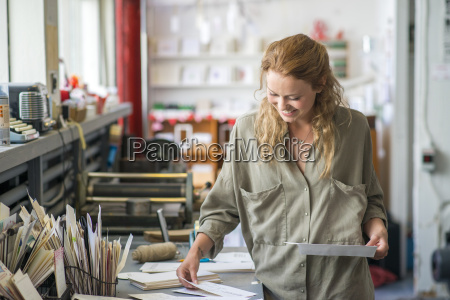 female print designer examining designs in